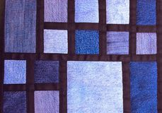 Blue quilt with jeans fabrics. Pattern with multi colored squares royalty free stock photos