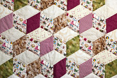 Quilt with pattern of squares. A quilt with beautiful colors and a pattern of squares in decoration for children Royalty Free Stock Photography