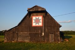 Quilt Pattern on Tobacco Barn. This is a Summer picture of a quilt pattern on a wooden tobacco barn located near Owensboro, Kentucky royalty free stock photography