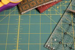 Quilt rotary cutting mat with fabric in background Royalty Free Stock Photography