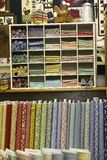 The Quilt Shop. Interior of a quilt shop with stacks of fat quarters and fabric bolts on display Royalty Free Stock Images