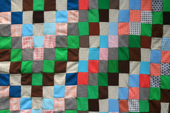 Quilt Texture. Homemade quilt sewn from various fabrics Royalty Free Stock Images