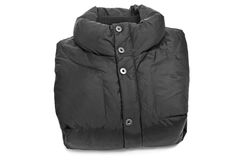 Quilted anorak. Folded black quilted anorak on a white background stock photography