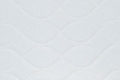 Quilted Background. Ivory white quilted background with pretty patterns Stock Images