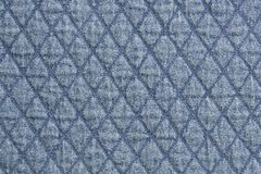 Quilted fabric blue denim cloth element texture close up background stock photo