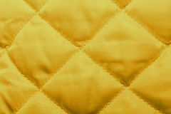 Quilted fabric texture of white color for hammering, Stock Photo