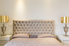 Quilted headboard bed Royalty Free Stock Images