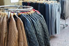Quilted jackets and jeans for sale Royalty Free Stock Photo