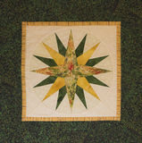 Quilted Northern Star. Green and Yellow quilted Northern Star Royalty Free Stock Photography