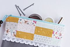 Quilted patchwork make up bag royalty free stock images
