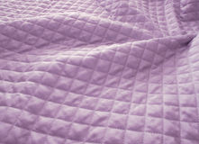 Quilted purple fabric Royalty Free Stock Image