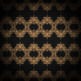 Quilted seamless pattern. Black color. Golden metallic stitching on textile. Stock Image