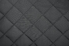 Quilted synthetic fabric texture background. Cloth in rhombus. Quilted synthetic fabric texture background Stock Image