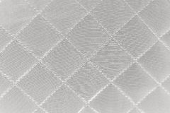 Quilted synthetic fabric texture background. Cloth in rhombus. Quilted synthetic fabric texture background Stock Photo