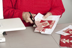 Quilter cutting seam allowance of fabric Royalty Free Stock Images