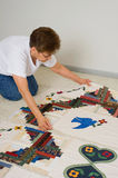 Quilter with fabric panels. A quilter lays out quilt panels prior to quilting them together Stock Images