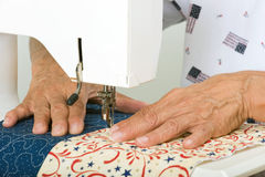 Quilter machine quilting. A woman sews panels together to be used for a tote bag Stock Photography