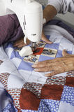 Quilter machine quilting patriotic quilt. Stock Photos