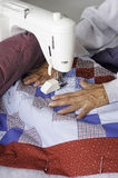Quilter machine quilting patriotic quilt. Royalty Free Stock Image