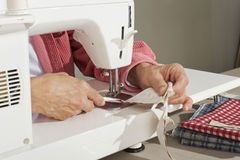 Quilter sewing fabric Royalty Free Stock Photos