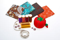 Quilting. Assortment of colorful fabrics and sewing tools for quilting Royalty Free Stock Photos