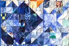 Quilting. Tiny patchwork squares forming quilt Royalty Free Stock Photo
