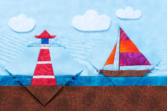 Quilting blocks yacht and lighthouse lie on same fabrics like sea landscape Stock Image