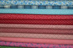 Quilting Fabric. Bolts of a variety of vintage quilt fabric Stock Photos