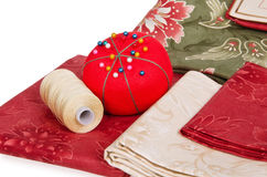 Quilting fabrics and pin cushion Royalty Free Stock Images
