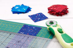 Free Quilting Tools, Piece Of Fabric Prepared To Cutting, Two Heaps Cut Off Of Fabrics Royalty Free Stock Photo - 92254995