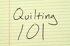 Quilting 101 On A Yellow Legal Pad. The words `Quilting 101` on a yellow legal pad Royalty Free Stock Photo