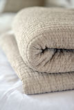 Quilts. Folded textured quits and throws in neutral earth tones Royalty Free Stock Photography