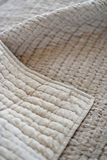 Quilts. Folded textured quits and throws in neutral earth tones Royalty Free Stock Photos