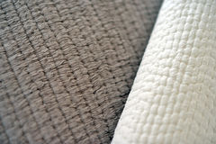 Quilts. Folded textured quits and throws in neutral earth tones Stock Photography