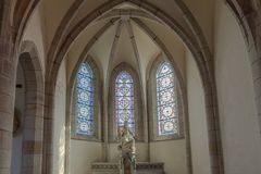 Interior view of the Saint Mathieu Church in Quimper in Brittany with statue and stained glass window details