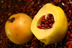 Quince. The cut fruit of a quince against seeds royalty free stock image