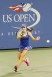 Quince años del jugador de tenis Catherine Bellis durante el segundo partido de la ronda en el US Open 2014 Fotografía de archivo libre de regalías