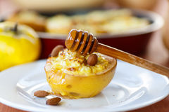 Quince baked with cheese Stock Image