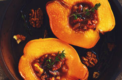 Quince baked with honey, walnut and thyme, close-up Stock Photos