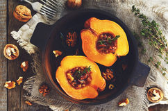 Quince baked with honey, walnut and thyme herb Stock Photos