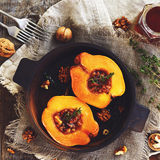 Quince baked with honey, walnut and thyme, square Royalty Free Stock Photos