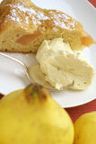 Quince batter cake: reverse angle. Cinnamon star anise poached, quince batter cake, with lemon vanilla cream. Quince fruit in foreground Royalty Free Stock Photography