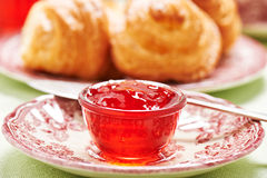 Quince-cranberry jelly in little glass bowl for breakfast Stock Image