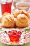 Quince-cranberry jelly in little glass bowl for breakfast Stock Photography