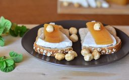 Quince And Fresh White Cheese On Bread Toast Stock Photo
