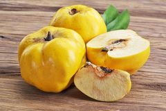 Quince fruits on wooden table. royalty free stock image