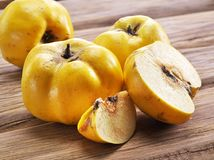 Quince fruits on wooden table. Royalty Free Stock Images