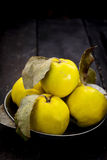 Quince in the iron plate on a dark background Royalty Free Stock Image