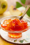 Quince jam. Sweet quince jam in glass dish with spoon Royalty Free Stock Image