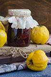 Quince jam. In a glass jar Stock Images